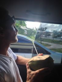 Drinking Coconut water on our way to the rain forest
