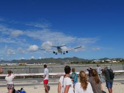 The planes land and take off really close to the beach.